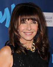 Mary Steenburgen's long waves looked totally retro with a bit of teasing at the crown and thick straight-across bangs.