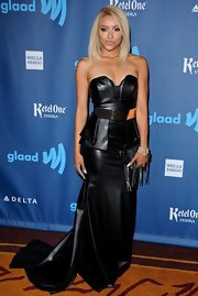 Kat Graham showed off her sexy side with this strapless black leather dress that featured a peplum top and a flowing train.