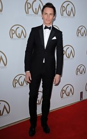 Eddie Redmayne wore a classic slim fit wool suit with satin lapels to the PGA Awards.