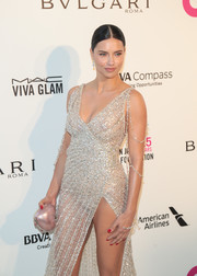 Adriana Lima attended the Elton John AIDS Foundation Oscar-viewing party carrying a metallic-pink heart-shaped clutch.