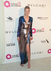 Toni Garrn dazzled in an iridescent wrap gown by Siran at the Elton John AIDS Foundation Oscar-viewing party.