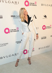 Karolina Kurkova worked a masculine-chic vibe in a white Balmain suit with contrast lapels at the Elton John AIDS Foundation Oscar-viewing party.