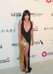 Lea Michele dropped jaws with this black and gold La Perla dress with a dangerously sexy neckline and slit at the Elton John AIDS Foundation Oscar-viewing party.