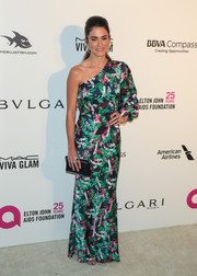 Nikki Reed was spring-glam in a one-sleeve foliage-print gown by Saloni at the Elton John AIDS Foundation Oscar-viewing party.
