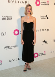 Hailey Clauson was all about refined elegance in a strapless black velvet dress by Monique Lhuillier at the Elton John AIDS Foundation Oscar-viewing party.