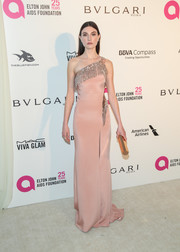 Jacquelyn Jablonski donned a blush Versace one-shoulder gown with metallic fringe detailing for the Elton John AIDS Foundation Oscar-viewing party.
