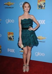 Jayma paired her strapless Tadashi dress with gold strappy sandals.