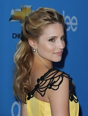 Dianne Agron paired her loose updo with dangling diamond round earrings.
