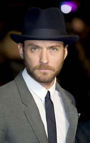Jude Law looked dapper at the BFI London Film Fest in a fedora and charcoal suit.