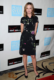 Calista Flockhart opted for a sleek but feminine black dress with floral print.