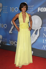 Wendy Raquel Robinson's embroidered yellow halter gown was one seductive number!