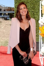 Mandy Moore went to the Veuve Clicquot Polo Classic carrying a stylish black-and-white tweed clutch.