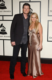 Miranda Lambert matched her petite clutch to her floor length satin gown.