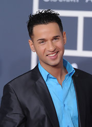 Mike wears his hair in a gelled hightop fade, his signature style, for the Grammy Awards.