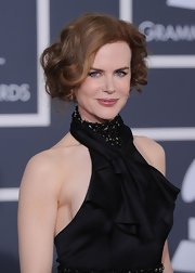 Nicole pinned her fiery red locks up for an effortless retro look, that was very fitting for her haltered satin dress.