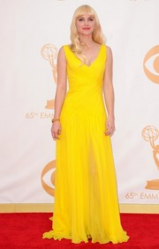 Anna stood out in a flowing V-neck gown in bold yellow.