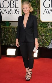 Amy Poehler has never looked better—just check out this sleek black pantsuit she wore to host the Golden Globe Awards.