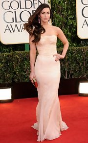 Megan Fox's strapless dress was beautifully reminiscent of a negligee with its romantic lace and silk layers.