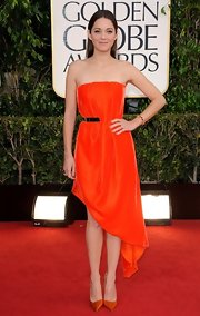 Marion chose a vibrant orange color in a luxe velvet fabric for the Golden Globe's red carpet.