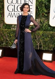 Morena looked uniquely elegant in this black and blue evening gown with delicate pleats and a beaded center panel.