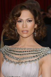 Jennifer Lopez teamed her Grecian influenced gown with bouncy chin length ringlets.