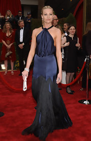 Portia glided down the red carpet in a midnight blue, halter gown with a draped bodice and a black fringe-embellished skirt.