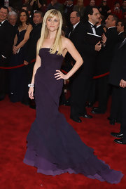Style darling Reese Witherspoon dazzled at the 2007 Academy Awards in a purple Nina Ricci gown. The gorgeous strapless gown featured cascading ruffles in ombre shades of purple, ranging from a deep eggplant to a soft lilac. Styled with sleek bangs and diamond jewelry, this look is absolute perfection!