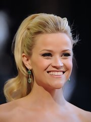 Reese Witherspoon rocked a retro  half up hairstyle to the 83rd Annual Academy Awards.