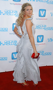 Brittany Snow added pop to her gorgeous blue and white striped dress with a ruby red satin clutch.