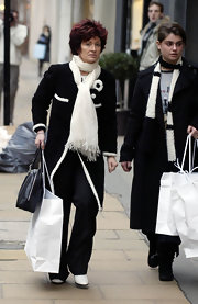 Sharon Osbourne wrapped a white scarf around her neck while out shopping with her daughter Aimee.
