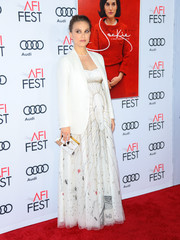 Natalie Portman topped off her gorgeous dress with a crisp white blazer, also by Dior.