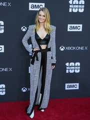 Lydia Hearst looked fierce in a Balmain houndstooth duster layered over a leather bra at the 'Walking Dead' 100th episode celebration.