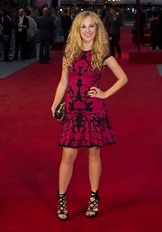 Juno Temple chose a bold black and bright pink flower blossom jacquard dress for the 'Anna Karenina' world premiere in London.