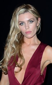 Abbey Clancy looked sensual in her cleavage-baring dress, hair cascading down one shoulder, at the Lingerie London fashion show.