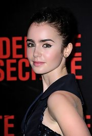 At the 'Abduction' premiere in Paris, Lily Collins sported some seriously sexy eyeliner. Her retro look is easy to duplicate by using liquid eyeliner. Start at the inner corners of eyes and sweep liner brush gently along the upper lash line, flicking the brush gently in an up and out motion at the outer corners.