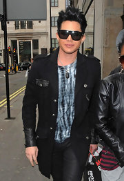 Adam rocked retro-inspired oversized shades while shopping in London.