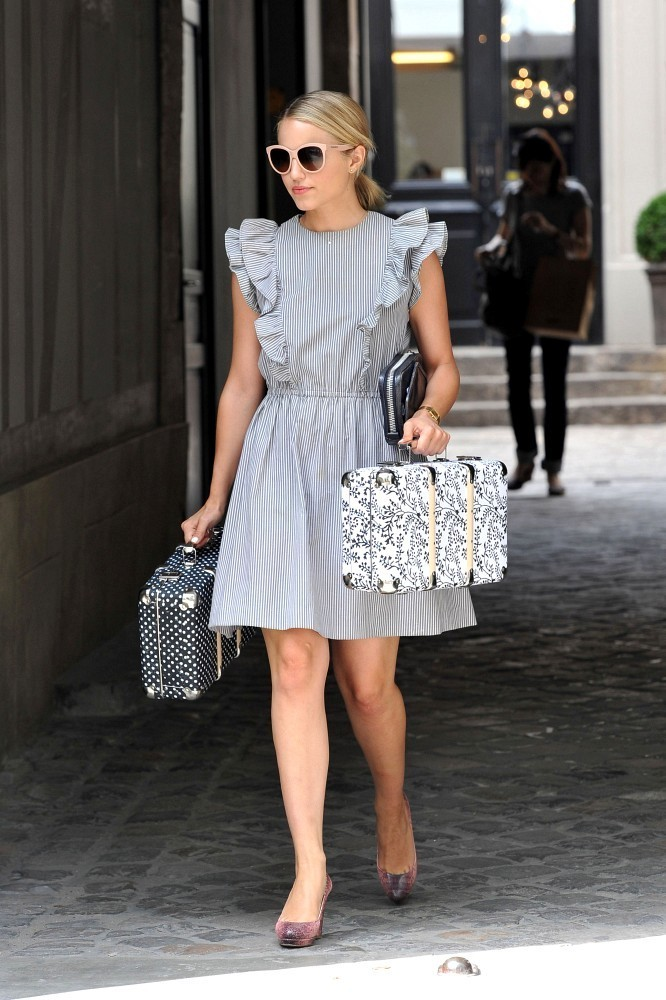 Diana Agron wears a pretty ruffled dress and carries a pair of small suitcases as she steps out for some shopping. The 'Glee' actress first stops into a Leica camera store, before purchasing a larger suitcase.