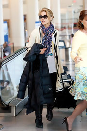 Dianna Agron arrived at LAX wearing her dark leopard print scarf.
