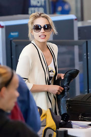 Dianna Agron was spotted at LAX in oversized blue London sunglasses.
