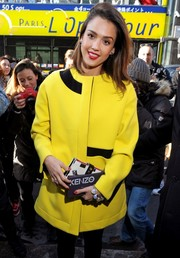 Jessica Alba brightened up the day in a sunny yellow coat at the Kenzo fashion show.