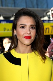 Jessica Alba accentuated her lips in glossy red at the Kenzo show at Paris Fashion Week.