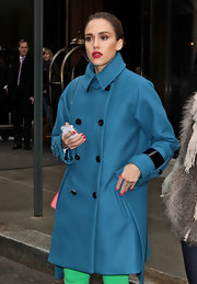 Jessica Alba swept on a couple coats of ruby red nail polish for fashion week in NYC.