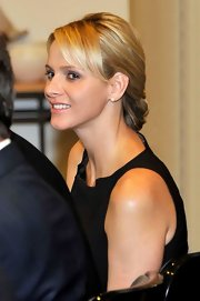 Prince Charlene of Monaco wore her hair in a chic French braid at a presentation for the Monaco Collectif Humanitaire organization.