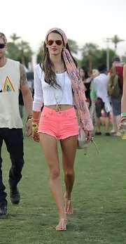 Alessandra Ambrosio topped off her totally hippie look with a pink floral head scarf.