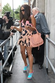 Alesha Dixon stepped out in London wearing turquoise peep toe booties with pink piping.