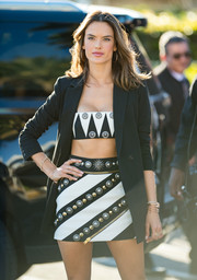 Alessandra Ambrosio paired her crop-top with an embellished striped mini skirt, also by Fausto Puglisi.