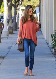 Alessandra Ambrosio was spotted out in LA wearing a stylish coral-red boatneck sweater.