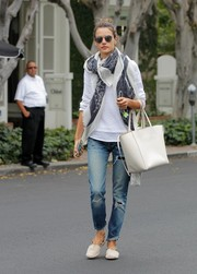 Alessandra Ambrosio pulled her outfit together with a white Celine Cabas Phantom tote.