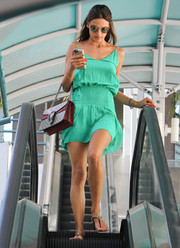 Alessandra Ambrosio looked cute and breezy in a green spaghetti-strap mini dress while shopping in Brentwood.