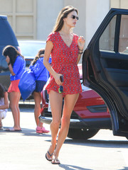 Alessandra Ambrosio was spotted out in LA looking breezy in a printed red romper.